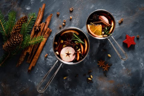Christmas mulled wine with spices. Traditional winter festive drink at holiday, top view