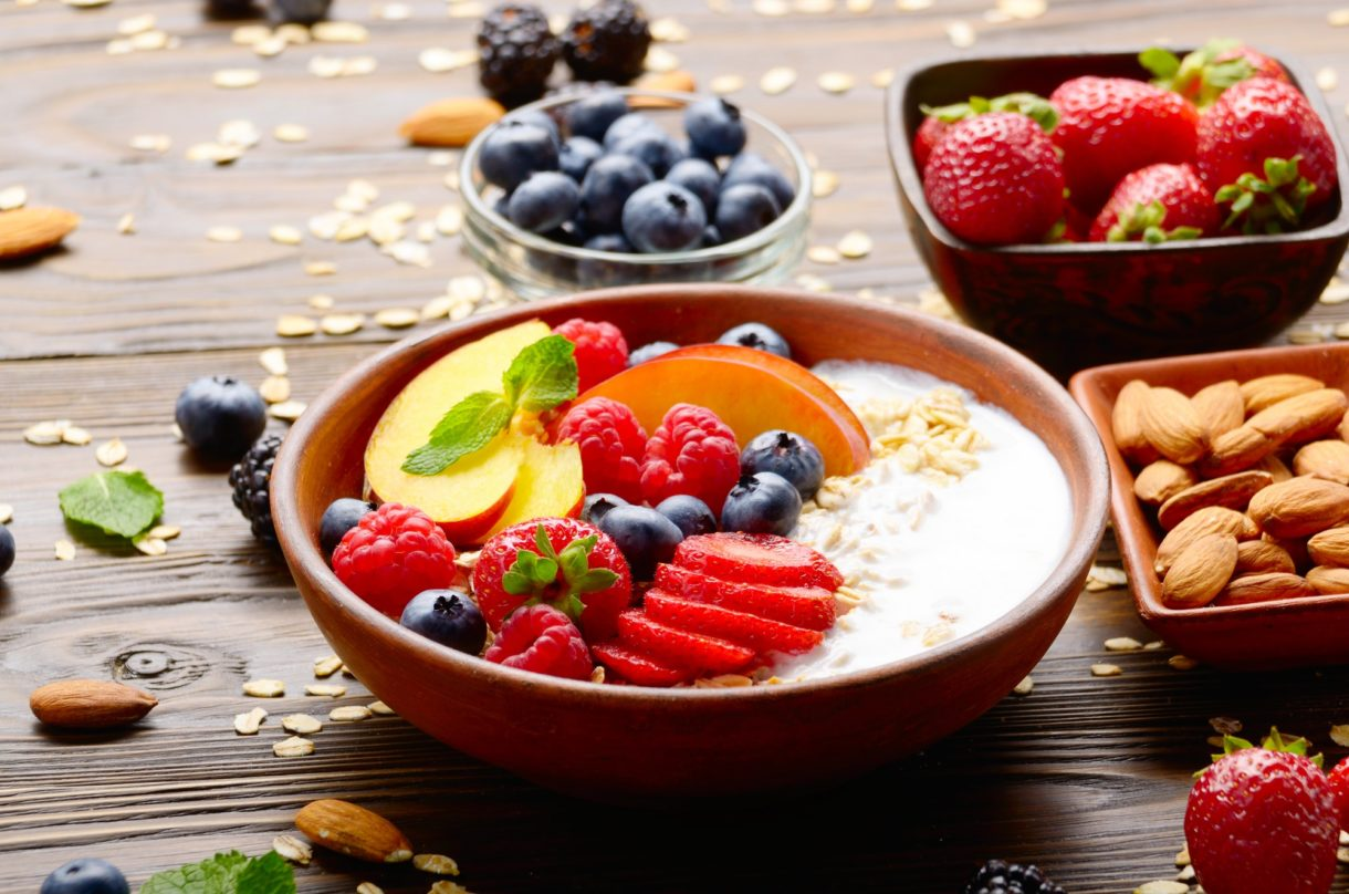 Fruit healthy muesli with peaches strawberry almonds and blackberry